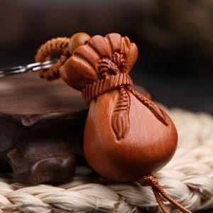 Porte-clé Bouddha – sac d'argent traditionnel